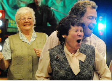 Hefina (Imelda Staunton) and Jonathan (Dominic West) get down.